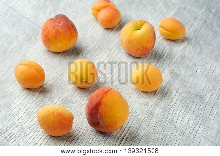 Peach and apricots on wooden table close up
