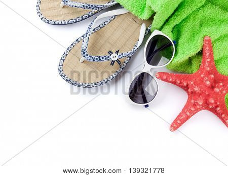 Beach accessories. Flip flops, towel, sunglasses and starfish. Isolated on white background. Top view