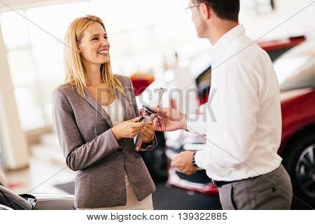 Customer buying a vehicle at car dealership