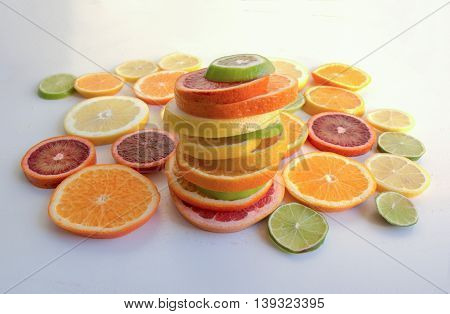 A Stack Of Different Slices Of Various Citrus Fruit