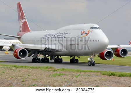 MANCHESTER, UK - SEPTEMBER 15, 2014 : A Virgin Atlantic 747 - 400 taxiing for departure at Manchester airport, UK