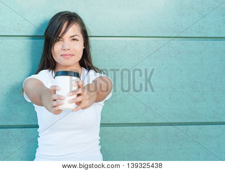 Smiling Attractive Girl Offering Cup Of Takeaway Coffee