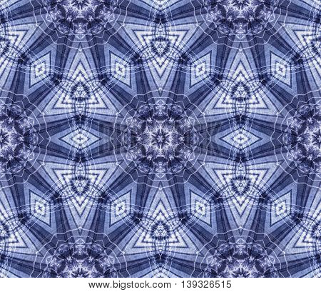 Abstract background pattern made from tie dye fabric kaleidoscope pattern endless pattern for wallpaper.