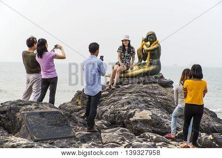 SIMILA BEACH SONGKLA THAILAND-Oct 24 2015: People shooting with Mermaid rock monument at Songkla beach Thailand.