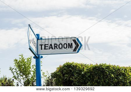 A signpost pointing the way to the tearoom UK