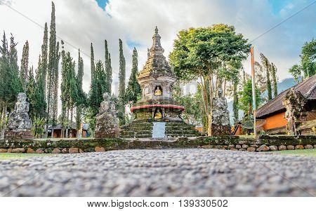 Buddhist stupa in gardens of Pura Ulun Danu pagoda temple on a lake Bratan Bali Indonesia