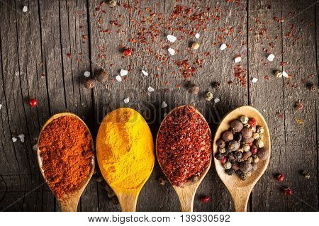 Spices. Food and cuisine ingredients. Colorful natural additives in wooden background.