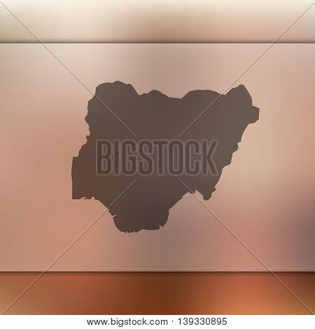 Nigeria map on blurred background. Blurred background with silhouette of Nigeria. Nigeria. Nigeria map.