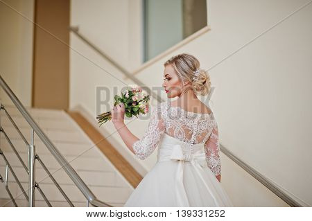 Gorgeous Blonde Bride Posed At Stairs Indoor Great Wedding Hall