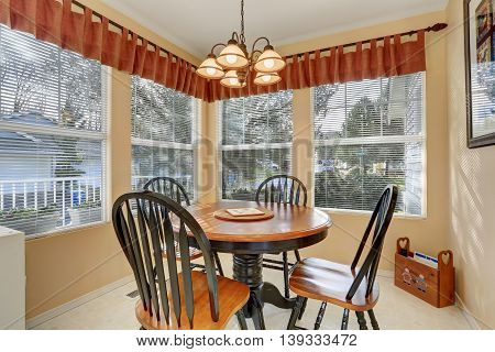Dining Area With Table Set And Windows Around