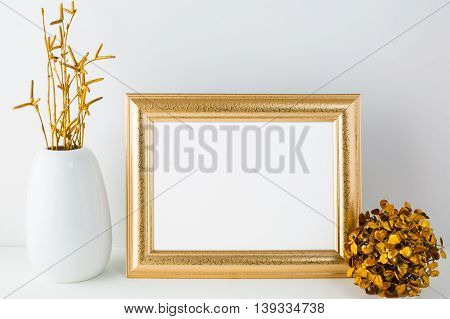 Gold frame mockup with golden decor. Landscape white frame mockup. Empty white frame mockup for presentation artwork.