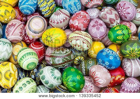 Colorful pile of decorated easter eggs full frame background