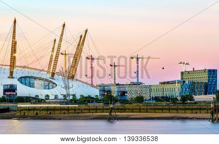 View of river Thames and O2 arena at sunset