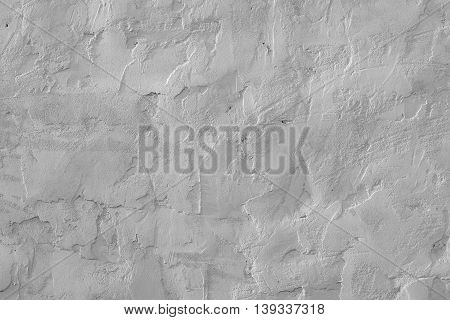 Rough gray plaster on a wall as a background
