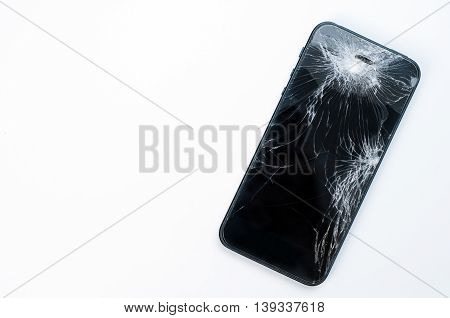 Mobile smartphone with broken screen isolated on white background with.