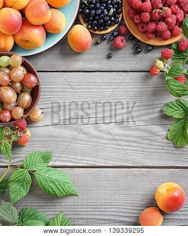 Fresh berries background. Studio photo of different berries on old wooden table. High resolution product. Copy space for your text.
