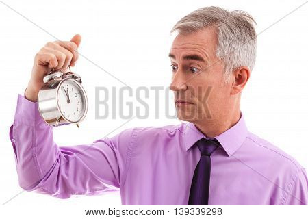 Scared businessman with clock in hand, isolated on white