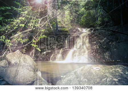 forest waterfall at sunrise, nature of Thailand, Asia