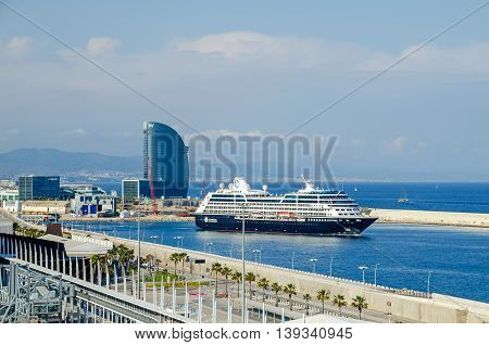 Barcelona Spain - June 2 2016: View of port Vell and its cruise terminal with cruise-liner Azamara and W Barcelona also known as the Hotel Vela (Sail Hotel).