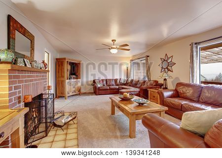 Cozy Living Room With Leather Sofa And Fireplace