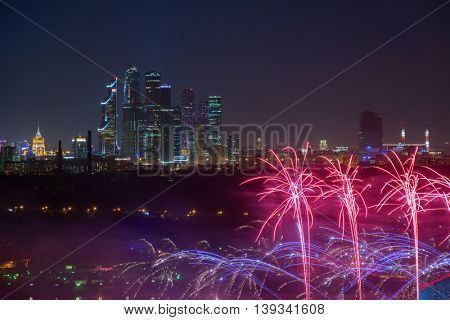 Skyscrapers of Moscow city and bright fireworks at night in Russia