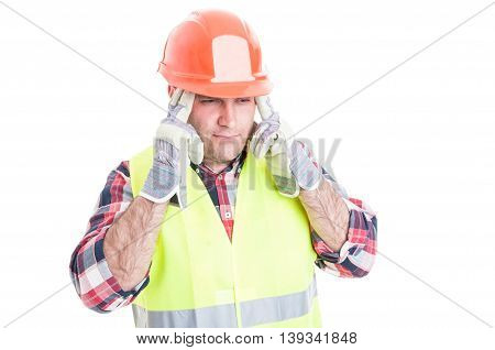 Stressed Male Builder Suffering From Headache