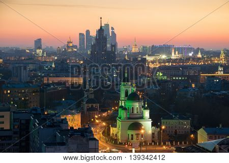Panorama, Temple of St. Sergius of Radonezh, Stalin skyscraper and office skyscrapers at sunset in Moscow