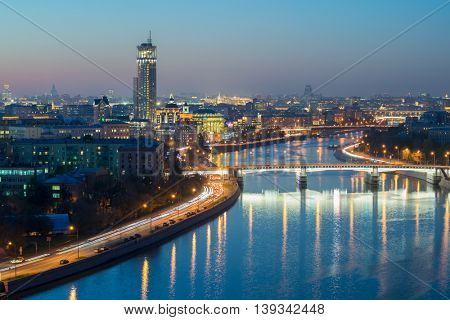 Gateway Bridge, drainage channel and evening panorama of Moscow