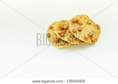 Traditional Malaysian cookies snack for Eid Fitr, Eid Adha and Ramadhan on isolated white background.