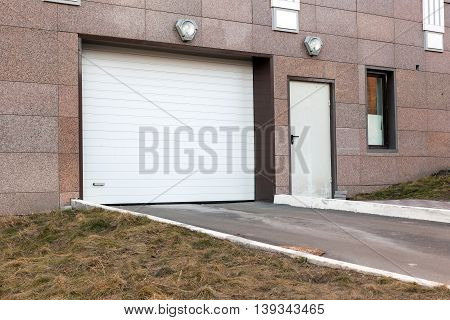 White and new garage door at a modern building