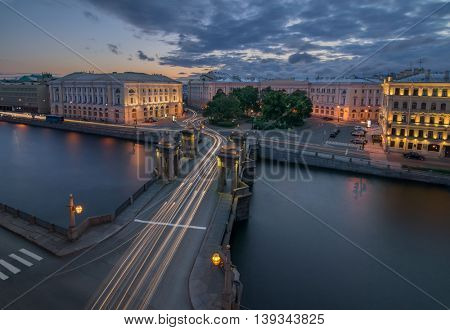 Lomonosov Bridge and Fontanka river in summer night St. Petersburg, Russia