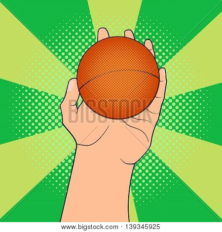 Game ball in hand in pop art style