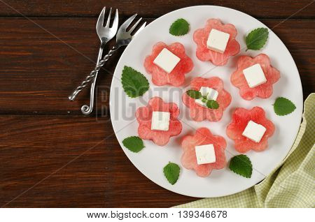 delicacy summer appetizer - sweet watermelon with salty soft cheese