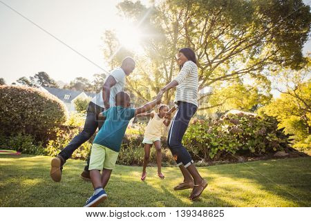 Happy family enjoying together at park