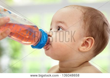 Baby enjoy to drinking some tea, close up