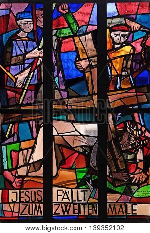 KLEINOSTHEIM, GERMANY - JUNE 08: 7th Stations of the Cross, Jesus falls the second time, stained glass window in Saint Lawrence church in Kleinostheim, Germany on June 08, 2015.