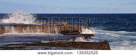 Waves splashing over rocks near Maroubra Beach Sydney.