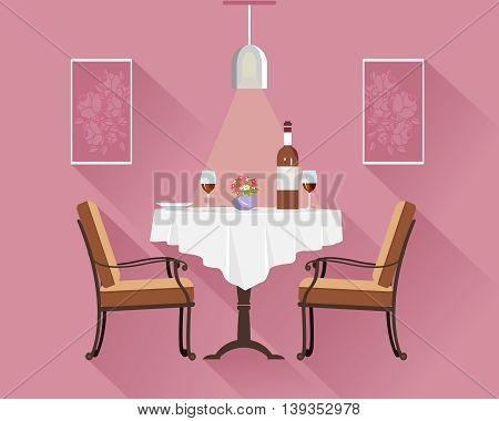 Flat style round restaurant table for two with white cloth, wine glasses, bottle of wine, plate and vase with flowers. Cafe interior with dinner table, chairs, lamp and pictures.