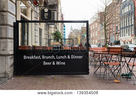 AMSTERDAM NETHERLANDS - NOVEMBER 15 2015: restaurant outdoor terrace serving brunch lunch dinner beer and wine