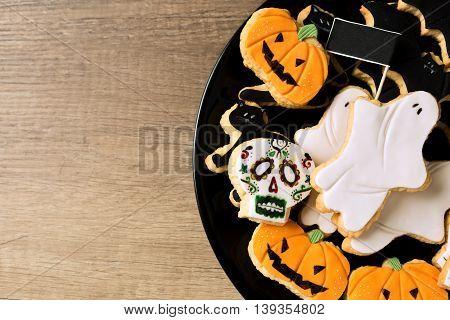 Happy Halloween Cookies On A Black Plate