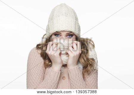 beautiful girl in winter fashion clothes on white