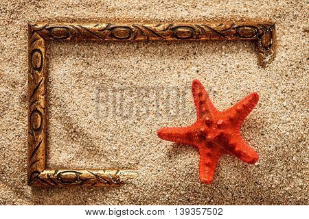 Frame in the sand with starfish