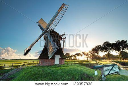 old Dutch windmill at sunrise Groningen Netherlands