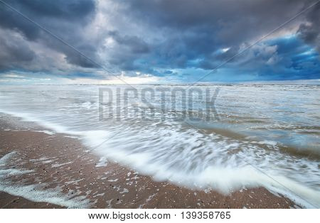 stormy day on North sea beach Netherlands
