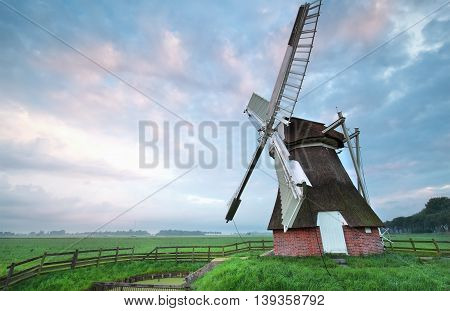 Dutch windmill at summer sunrise Groningen Netherlands