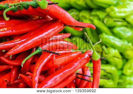 red and green peppers with a blurred background