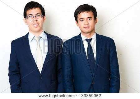 Give We Care Your Business Portrait Of Handsome Happy Asian Young Cool Business Men