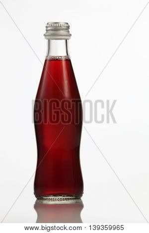bottle of the black currant drink on the white background