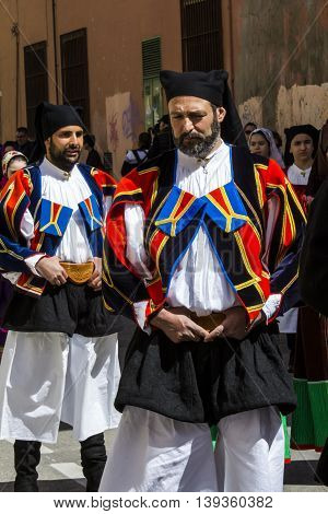 CAGLIARI, ITALY - May 1, 2016: 360 ^ Sant'Efisio Festival - Sardinia - group of people parading in traditional Sardinian costume