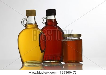 honey,agave syrup and maple syrup on the white background